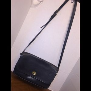 Coach's Vintage Black Leather Crossbody Messenger